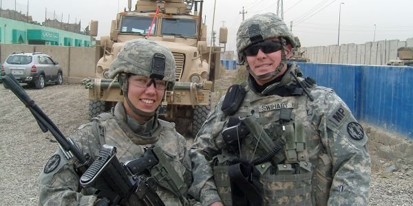 Spouses Danielle and Chris Swihart served together in the U.S. Army's Military Police Corps....