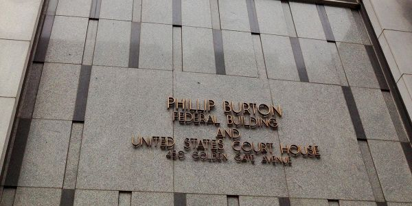 A former Audi and Volkswagen dealership manager settled embezzlement charges with a plea...