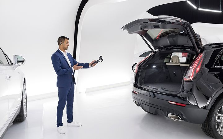 Cadillac Live agents are trained to conduct walkarounds and answer vehicle and purchase-consideration questions.  - Photo courtesy General Motors Co.