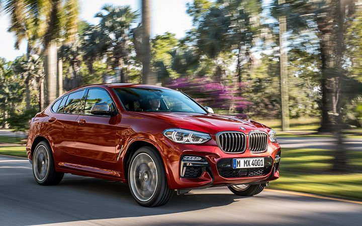 NADA analysts predict the increasing fuel efficiency of light-duty pickups and CUVs such as the BMW X4 will continue to push more consumers away from car segments.  - Photo courtesy BMW Group
