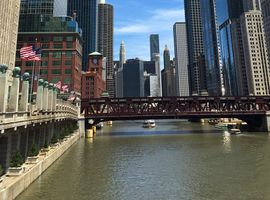 A lawsuit against Perillo Motor Cars claims workers hired by the Chicago dealer group illegally dumped materials in the Chicago River, polluting the water and causing a seawall to collapse.