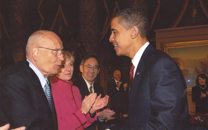 Dingell, pictured with newly elected President Barack Obama in 2009, was awarded the Presidential Medal of Freedom in 2014. 