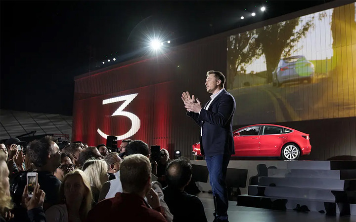 """Tesla has brought its long-awaited $35,000 Model 3 sedan to market at the expense of most of its physical retail centers and 7% of its workforce. CEO Elon Musk told a reporter """"Good luck with that"""" when asked whether he feared a legal challenge from U.S. franchised dealers.   - Vimeo"""