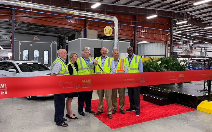 Executives, employees, clients, local business leaders, and elected officials gathered April 9 to celebrate the unveiling of Manheim Orlando's new 80,000-square-foot reconditioning center. 