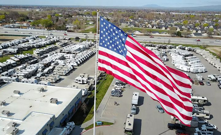 A 40-by-80-foot American flag continues to fly over Gander RV of Statesville, N.C., despite protests from city leaders. 