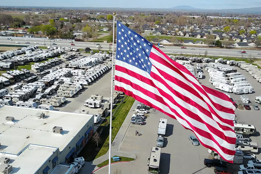 A 40-by-80-foot American flag continues to fly over Gander RV of Statesville, N.C., despite...
