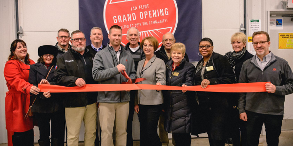 Employees and guests gathered to mark the grand opening of IAA Flint (Mich.), a new facility...