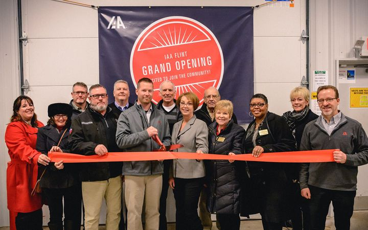 Employees and guests gathered to mark the grand opening of IAA Flint (Mich.), a new facility that replaces IAA Great Lakes in Bay City.   - Photo courtesy KAR Auction Services