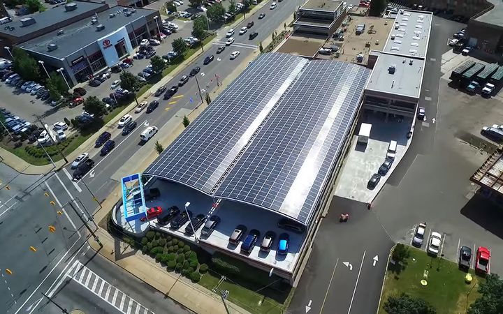 Foundation Honda's parking structure is covered by a massive solar canopy that is made from 80% recycled vehicles and generates 1.3 megawatt hours of electricity per day — enough to power 40 homes. 