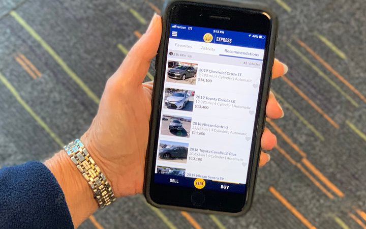 The latest upgrades to Manheim's mobile app were designed to provide dealers greater control with offer management and personalized vehicle recommendations.   - Photo courtesy Manheim