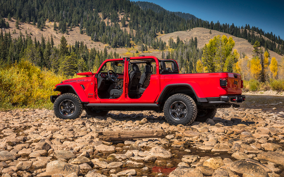 The Gladiator sports several Wrangler-like features, including removable doors and a fold-down...