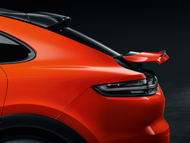 When the speedometer hits 56 miles per hour, anadaptive spoiler extends by 5.3 inches to apply...