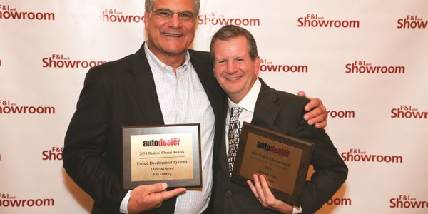 Randy Crisorio (left), president and CEO of United Development Systems Inc. and Jeff Jagoe,...