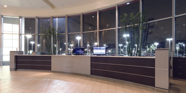 At John Elway's Crown Toyota in Ontario, Calif., a sales manager bar takes the place of the...