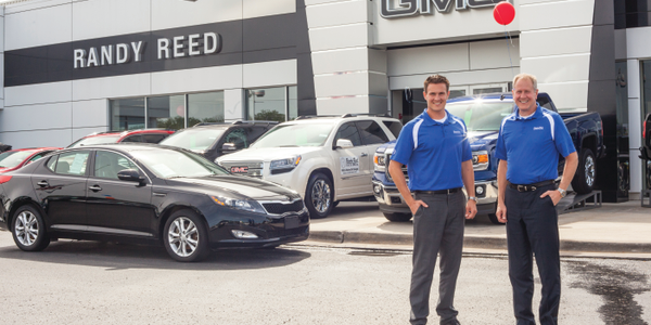 Randy Reed (right), owner and president of Randy Reed Automotive, stands with son Trevin, the...