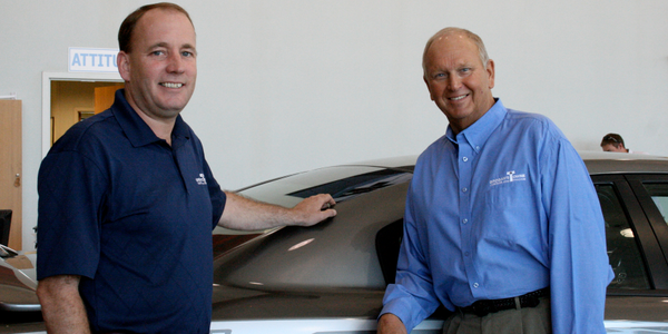At Grogan's Towne Chrysler Jeep Dodge, Marc Ray, GSM and partner (left), and...