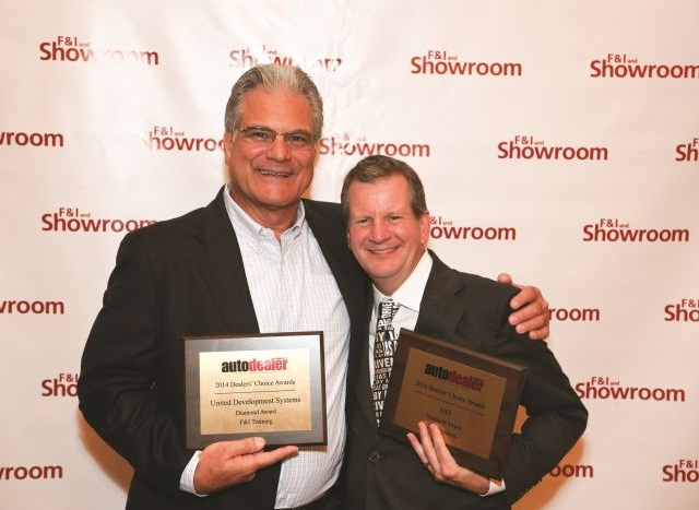 Randy Crisorio (left), president and CEO of United Development Systems Inc. and Jeff Jagoe, senior vice president of agency operations for IAS, celebrate their companies' Diamond Award wins for F&I Training and F&I Products.