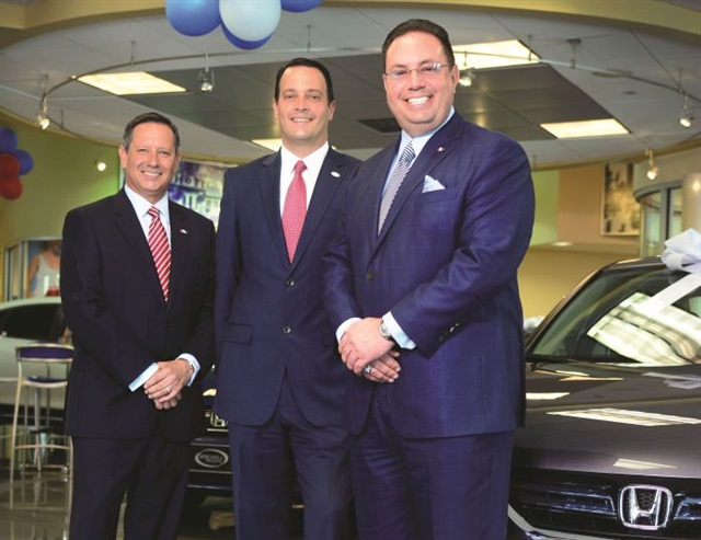 Mario Murgado (right), owner of Miami's Brickell Motors, stands with partners Rick Barraza (left) and Alex Andreus.