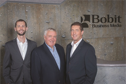 Ed Bobit stands with his son, Ty Bobit, president and CEO of Bobit Business Media, and grandson Blake Bobit, who joined the company in 2010.