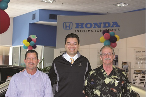 Jason Olesnavage stands with the service team at Auburn Honda. Several techs have worked at the store since it opened, and Olesnavage credits the team with helping drive customer loyalty.