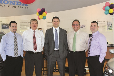 Sales managers Graham Fernandez, Clark Osborne, and Jim Hitchcock, Olesnavage and Finance Manager Andrew Hamilton-Torrey work together to keep the dealership running at peak efficiency.