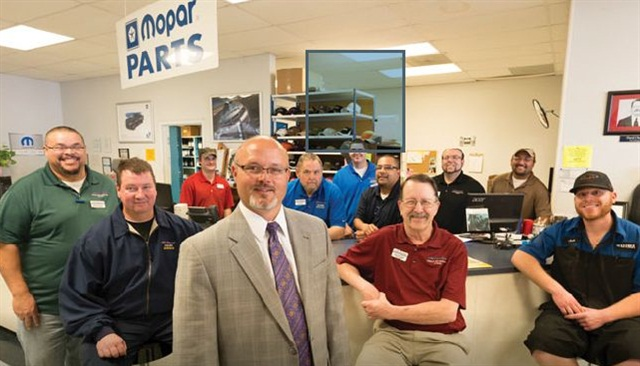 Pictured is General Manager Larry Hook and the parts department at All American Chrysler Jeep Dodge of Odessa, Texas.