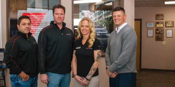 Sales professional Tracy Heid is flanked by (from left) owners Steve Ganser and pat McNamar and...