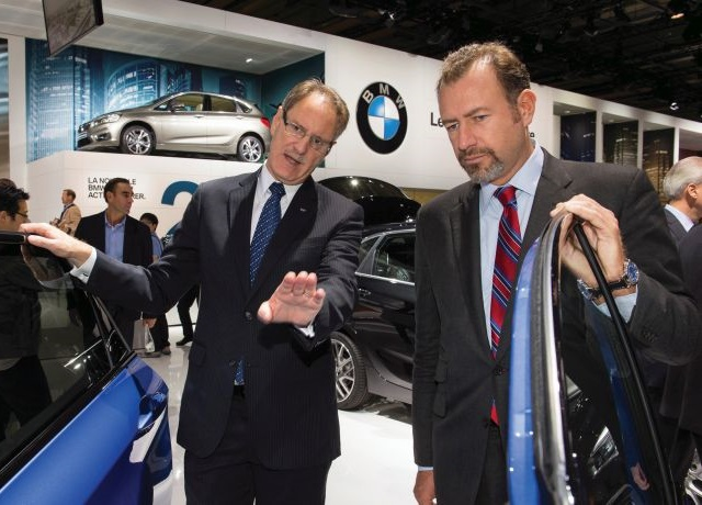 Johan de Nysschen (left), president of General Motors' Cadillac division, stands with Dan Amman, president of GM, at the Paris Motor Show. Ziegler fears de Nysschen's plan to reposition Cadillac as a European highline competitor could lead to the brand's demise. Courtesy General Motors