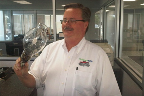 <p>Wayne Farrell, sales manager at Mullinax Ford, gets a firsthand look at the next generation bulb being shown first at the Orlando dealership as part of the first U.S. demonstration of how auto dealerships can support