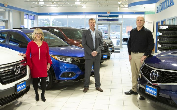 In 2017, Finance Director Cindy Merry, Co-Principal Owner Marten Martensen, and Sales Director Larry Newell implemented Newell's plan to revolutionize sales at Continental Auto Group's four Anchorage, Alaska, rooftops.  - Photo by David Jensen Photography