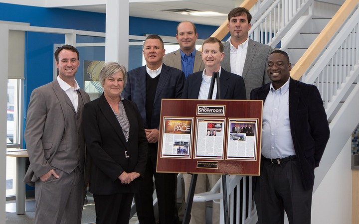 The group's productive and profitable finance department includes (left to right) Robert Smith, Teri Underwood, Brad Richardson, Cleat McAlister, Shawn Parrish, Lewis Hurst, and Bobby Wilson. 