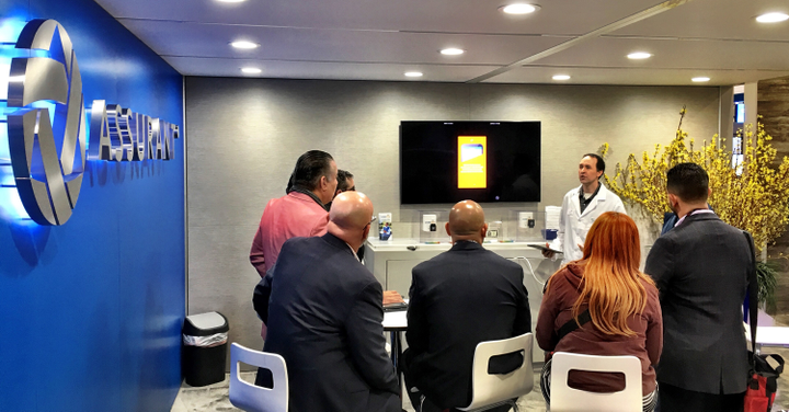 Director of Innovation Design for Global Automotive Dan Gronsbell conducted demos at Assurant's booth on the NADA show floor.   - Photo courtesy Assurant