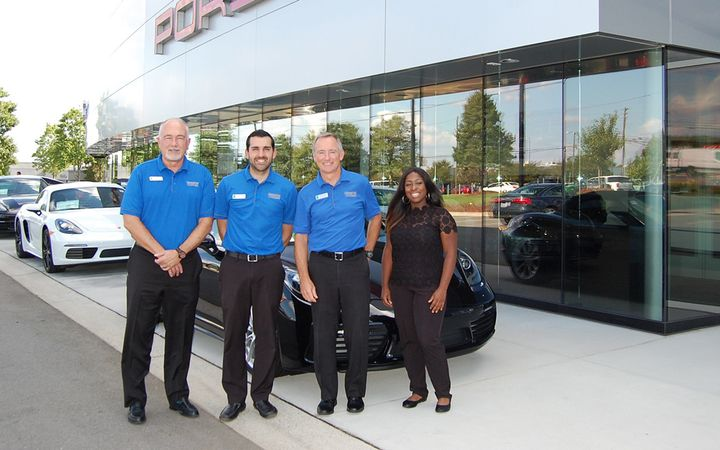 Hendrick Porsche's F&I and customer experience team includes Financial Services Manager Mark Solomon, Variable Operations Manager Albie Blanco, General Manager David Foster, and Customer Experience Manager Whitney Ray. 