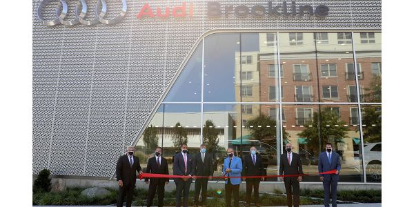Renovations create modern luxury dealership providing definitive Audi shopping experience.