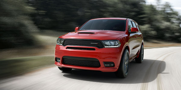 Interest in SUVs such as the Dodge Durango rose sharply at the expense of sports cars and luxury...