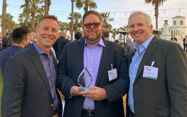 Division president Scott Blind, Scott Goodwin, vice president of OEM services, and Joseph Hynes, OEM services operations director, accepted KhS's Top Quality award at the 2019 Finished Vehicle Logistics North America Conference. 