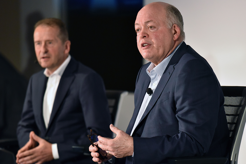 Volkswagen AG CEO Dr. Herbert Diess (left) and Ford Motor Co. President and CEO Jim Hackett...