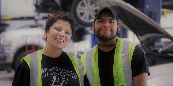 Former security guard Samantha Flores (left) has joined the Manheim Apprentice Program at the...