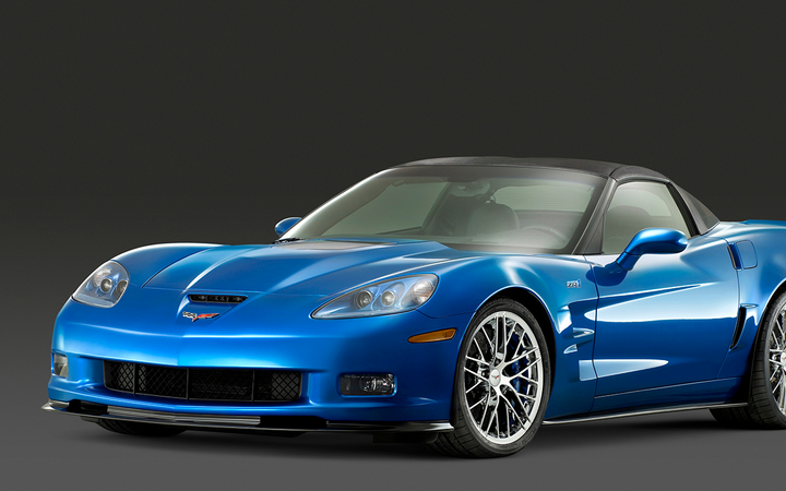 A former dealership employee is accused of stealing a customer's identity in pursuit of a sixth-generation Chevrolet Corvette. 