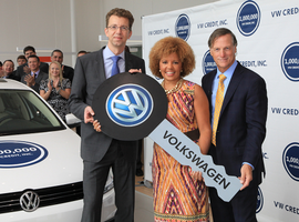 Flanked by Volkswagen Credit's Christian Dahlheim (left) and Jimmy Ellis of Atlanta's Jim Ellis Automotive Group, Linda Gaines was honored as the captive finance company's one millionth customer in 2013. VW Credit ranks No. 1 among captives in J.D. Power's latest U.S. Dealer Financing Satisfaction Study.