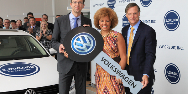 Flanked by Volkswagen Credit's Christian Dahlheim (left) and Jimmy Ellis of Atlanta's Jim Ellis...