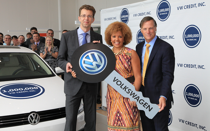 Flanked by Volkswagen Credit's Christian Dahlheim (left) and Jimmy Ellis of Atlanta's Jim Ellis Automotive Group, Linda Gaines was honored as the captive finance company's one millionth customer in 2013. VW Credit ranks No. 1 among captives in J.D. Power's latest U.S. Dealer Financing Satisfaction Study. - Photo courtesy Volkswagen AG
