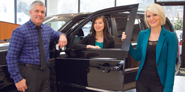 Northwest Honda's GM Tony Carter and business managers Sam Baylasy (center) and Camille Kim...