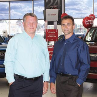 "F&I Director Tom Wilson (left) said he was convinced to join Riverside Auto Group after Tim Dagenais (right) told him, ""We're a family company. We put more value in family and in people than we do in profits."""