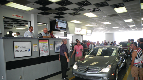 Auction buyers clear the way for vehicles moving through the lanes at Manheim Riverside in...