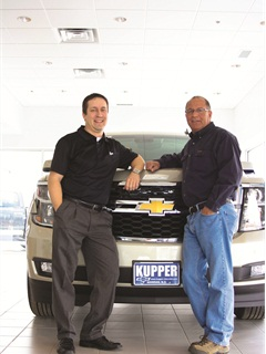Standing with Dealer Bob Kupper is Business Manager Mike Kapla, a North Dakota native who joined the dealer group six years ago.
