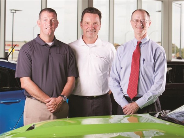 Sean Tarbell, vice president, Dawson Grimsley, president, and Stuart Ray, treasurer, are the co-owners of Wichita-Kan.-based Davis-Moore Automotive. Photo courtesy of Squid Ink creativ