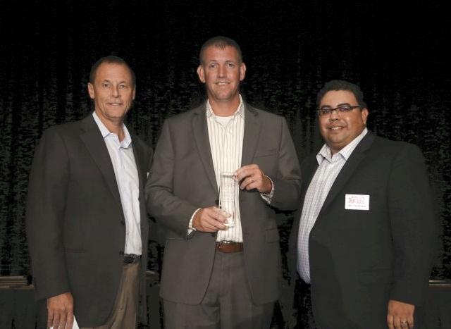 Accepting The Warranty Group-sponsored F&I Dealer of the Year award on behalf of Davis-Moore Automotive was Sean Tarbell. He's flanked by Ash Bauer an executive with The Warranty Group and F&I and Showroom's Gregory Arroyo.