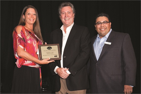 Stephanie Cooper, standing with IAS's Bob Corbin and F&I and Showroom's Gregory Arroyo, accepts her award after being named winner of the 2013 F&Idol contest at the F&I Conference in Las Vegas.