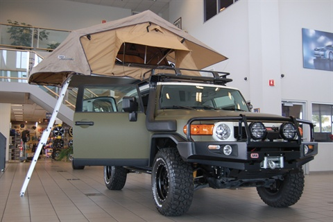 The XPLORE edition FJ Cruiser, shown above, sports a rooftop tent, off-road tires and XPLORE badging.